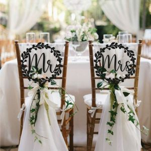 Mr and Mrs Signs on back of chair