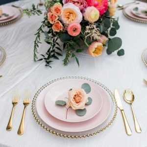 Blush Dishes with gold flatware