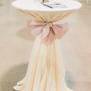 Ivory tablecloth with pink sash