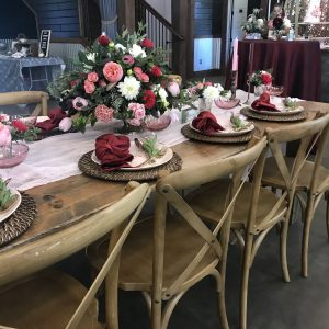 Wooden farm table with wood chairs