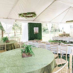 White tent with tables and chairs